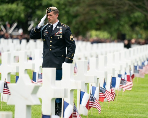 American Soldier Saluting Troops at Cemetery
